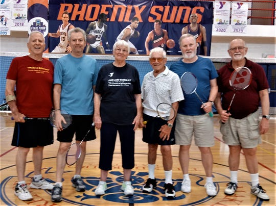 Downtown YMCA badminton players (from left) Jerry Harris, Johnnie Grgurich, Joan Kalfahs, Chuck Fine, Tom Davey, and Grant Buma pose between matches, 2019.
