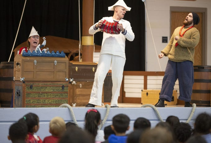 Childsplay actors Kate Haas, left, Tommy Strawser, and Marshall Vosler, perform Suzette Who Set to Sea for Arredondo Elementary students on December 18, 2019 in Tempe. Childsplay is a nonprofit that brings performances to schools.