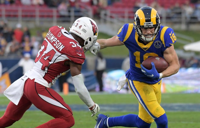 Dec 29, 2019; Los Angeles, California, USA;  Los Angeles Rams wide receiver Robert Woods (17) is defended by Arizona Cardinals strong safety Jalen Thompson (34) in the fourth quarter of the final Rams home game at Los Angeles Memorial Coliseum before moving to SoFi Stadium for the 2020 season. The Rams defeated the Cardinals 31-24 Mandatory Credit: Kirby Lee-USA TODAY Sports