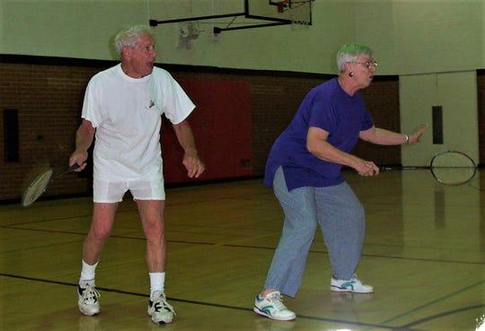 Chuck Fine, left, and Joan Kalfahs prepare to receive the shuttlecock, 2005.