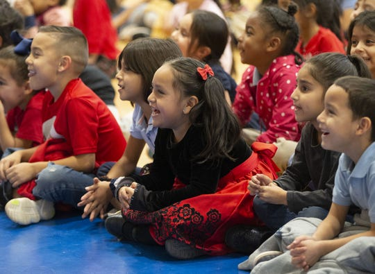Arredondo Elementary kindergartener Yamileth Hernanadez, center, has a laugh during a performance of Suzette Who Set to Sea by Childsplay on December 18, 2019 in Tempe. Childsplay is a Tempe nonprofit that brings performances to schools.
