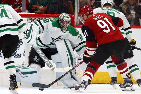 Arizona Coyotes left wing Taylor Hall (91) gets set to shoot against Dallas Stars goaltender Anton Khudobin (35) during the first period of an NHL hockey game Sunday, Dec. 29, 2019, in Glendale, Ariz. (AP Photo/Ross D. Franklin)