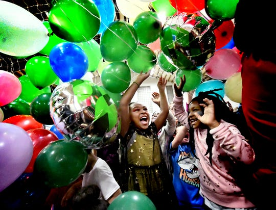 Children are cascaded by balloons during the Children's New Year's Eve Countdown at Voni Grimes Gym. My first photo of 2019 caught the celebratory mood! Bill Kalina photo