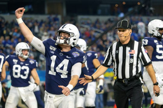 ARLINGTON, TX - DECEMBER 28: Penn State Nittany Lions quarterback Sean Clifford (14) celebrates in the end zone after a touchdown during the Cotton Bowl Classic college football game against the Memphis Tigers on December 28, 2019 at AT&T Stadium in Arlington, Texas. (Photo by William Purnell/Icon Sportswire) (Icon Sportswire via AP Images)