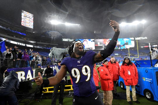 Baltimore Ravens outside linebacker Matt Judon holds a smartphone while celebrating after an NFL football game against the Pittsburgh Steelers, Sunday, Dec. 29, 2019, in Baltimore. The Ravens won 28-10. (AP Photo/Nick Wass)