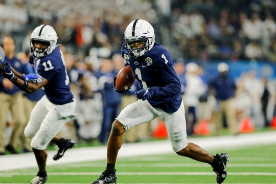 ARLINGTON, TX - DECEMBER 28: Penn State Nittany Lions wide receiver KJ Hamler (1) catches a pass and turns upfield during the game between the Penn State Nittany Lions and the Memphis Tigers on December 28, 2019 at AT&T Stadium in Arlington, Texas. (Photo by Matthew Pearce/Icon Sportswire) (Icon Sportswire via AP Images)
