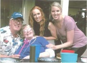 Traci Trout (center) is pictured with her husband, Len, and two daughters, Tiffany and Crystal (left to right) before her death in 2018.