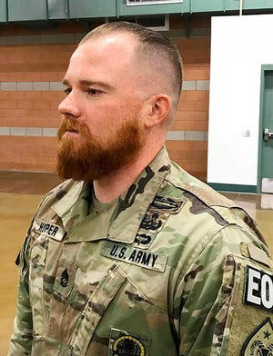 This August, 2019 photo provided by the Nevada Army National Guard shows Sgt. 1st Class Benjamin Hopper of the Nevada Army National Guard at a deployment ceremony in Nevada. Hopper, who is serving in Afghanistan, has received a uniform religious exception to sport a beard based upon his Norse pagan beliefs. He is the first guard soldier to receive a religious accommodation approval for a beard.