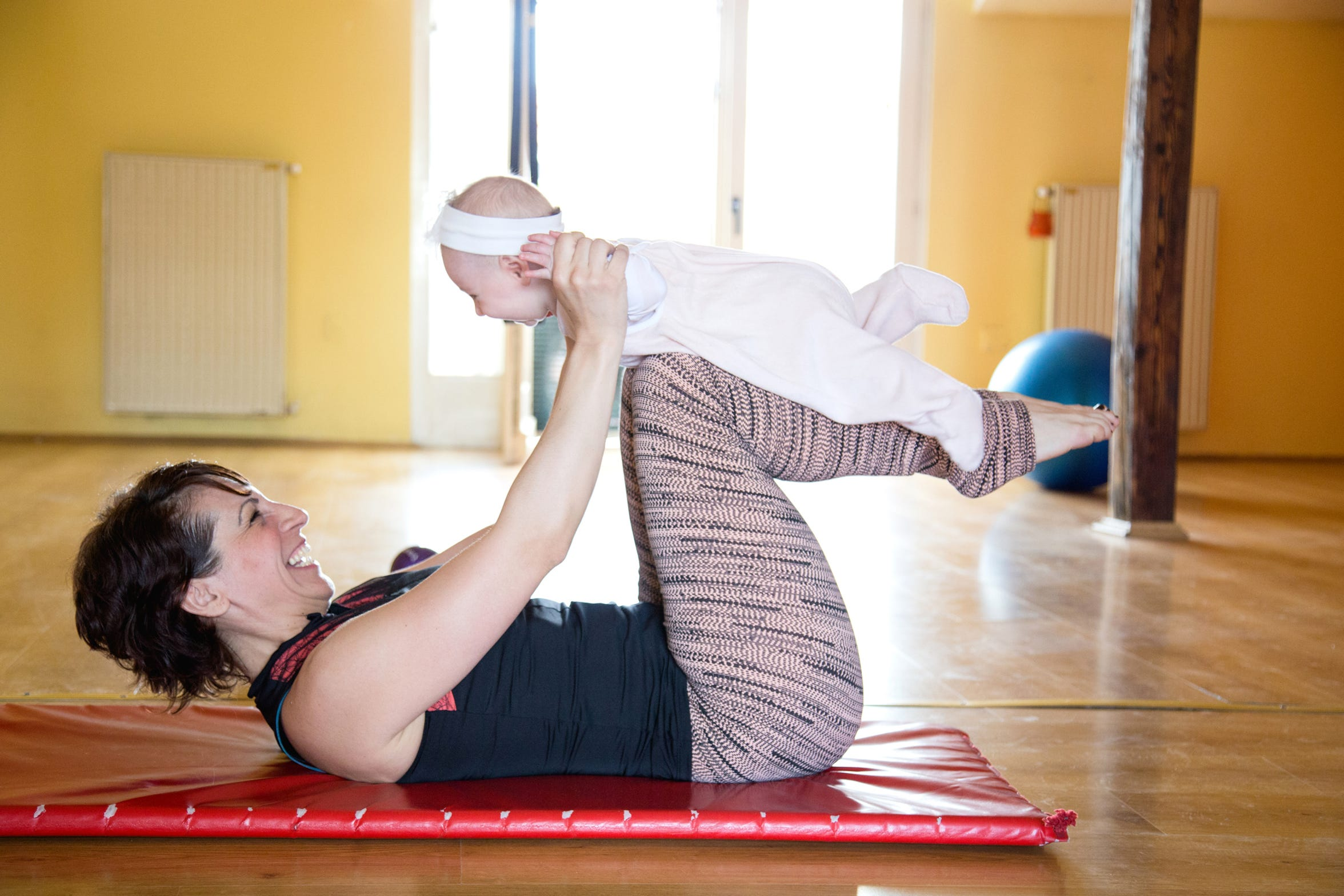 Light physical activity like yoga or a walk can be a great boost for a new mother's mental and physical health.
