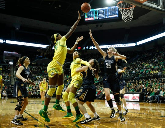 Oregon forward Ruthy Hebard (24), shoots against Corban in an exhibition college basketball game Saturday, Dec. 28, 2019, in Eugene, Ore.