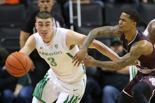 Oregon's Payton Pritchard, left, steals the ball from Texas Southern's Tyrik Armstrong during the first half of an NCAA college basketball game in Eugene, Ore., Saturday, Dec. 21, 2019.