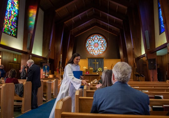 Rector Alejandra Trillos of St. Paul's/San Pablo Episcopal Church greets members of the congregation before her official installment on Dec. 07, 2019.
