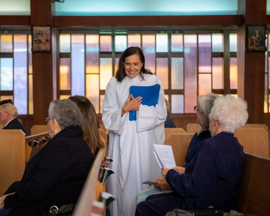 Rector Alejandra Trillos of St. Paul's/San Pablo Episcopal Church smiles as she talks to members of the congregation before her official installment on Dec. 07, 2019.