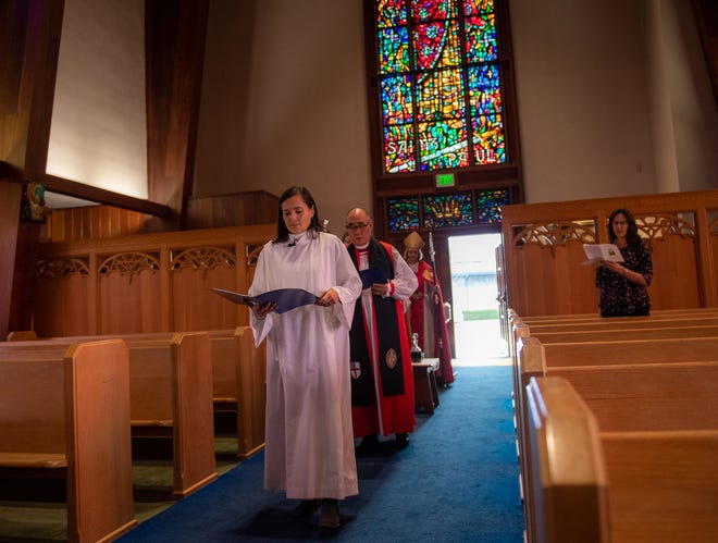 Rector Alejandra Trillos of St. Paul's/San Pablo Episcopal Church walks down the aisle during her official installment  on Dec. 07, 2019.