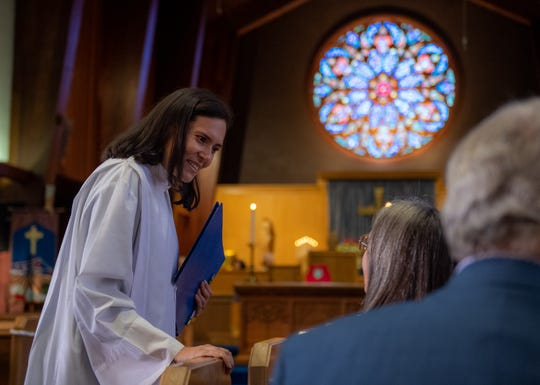 Rector Alejandra Trillos of St. Paul's/San Pablo Episcopal Church talks to members of the congregation before her official installment on Dec. 07, 2019.