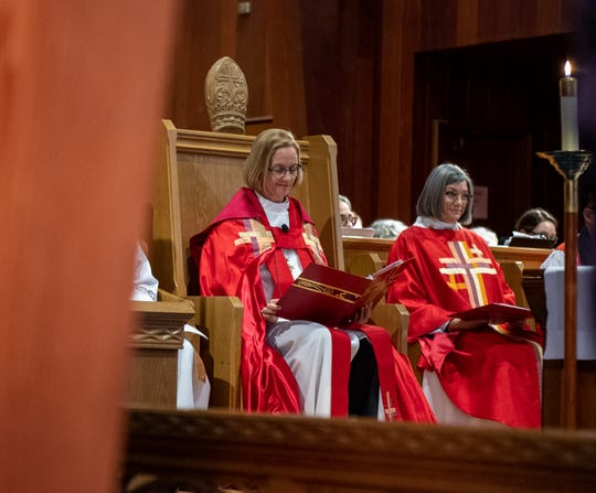 Leaders of the Episcopal Church sit by the altar inside the St. Paul's/ San Pablo Episcopal Church during the installment of Alejandra Trillos on Dec. 07, 2019.