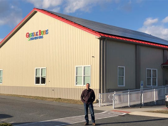 Businessman Richard Spinks stands outside his Gigglebugs early learning center in Millsboro.