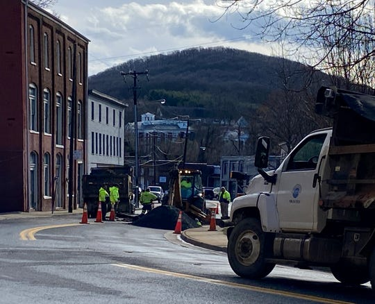 Public works employees remained on the scene Monday morning to repair a water main break on Greenville Avenue near the intersection of South New Street.
