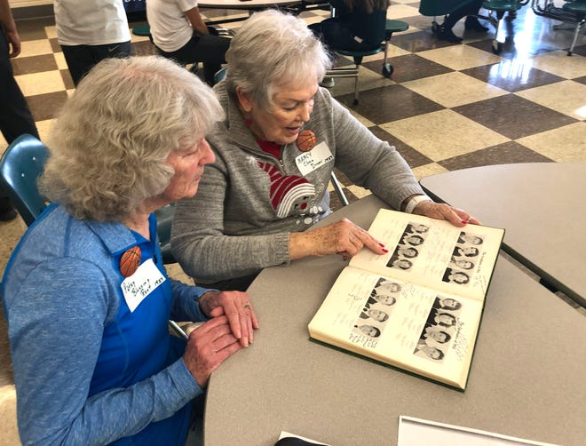 Patsy Blessing Root (left) and Nancy Cline Driver took part in a reception Saturday, Dec. 28, to honor former Wilson Memorial women basketball players. Root and Driver played on the undefeated 1953-54 Wilson basketball team.