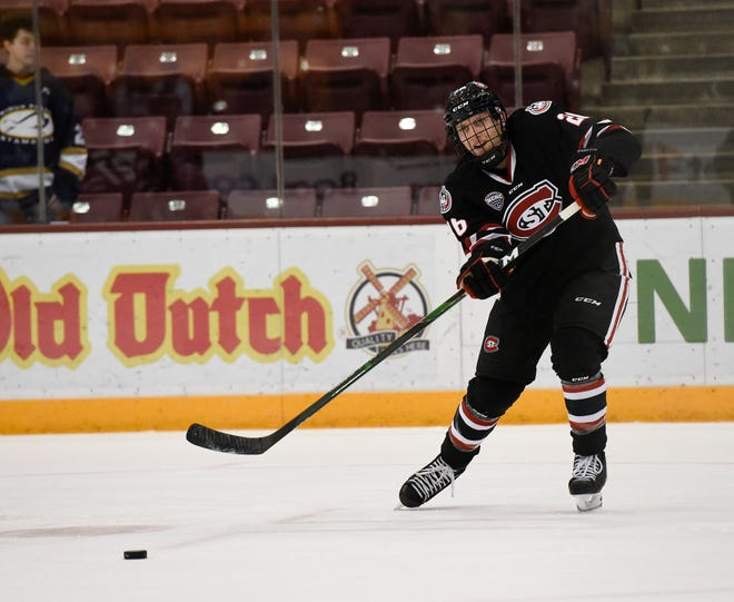 St. Cloud State junior Easton Brodzinski makes a pass in warmups before taking on Minnesota Sunday, Dec. 29, 2019, at 3M Arena at Mariucci.