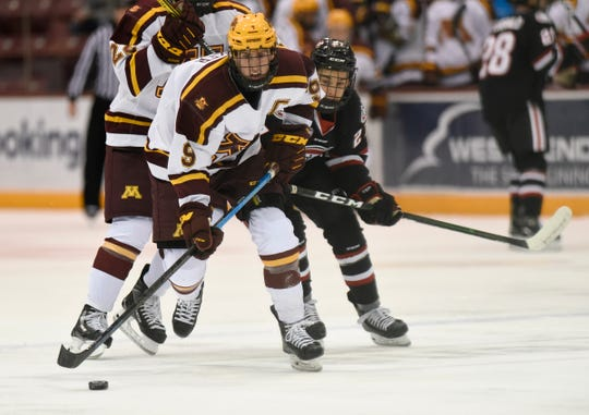 Minnesota sophomore Sammy Walker skates with the puck against St. Cloud State Sunday, Dec. 29, 2019, at 3M Arena at Mariucci.