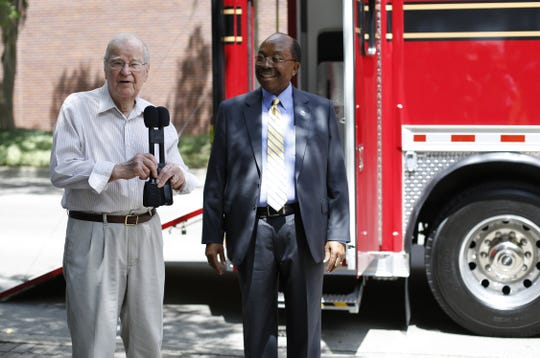 2017: Former Tallahassee Mayor Gene Berkowitz, left, and City Commissioner Curtis Richardson speak at the unveiling of the Fire Department's new Haz-Mat vehicle at Kleman Plaza.