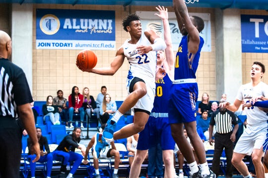 TCC guard DeAndre Gholston looks to find an open man versus Monroe College.