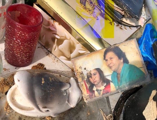 This photograph, which depicts a woman and a young girl, was one of several personal items salvaged Saturday, Dec. 21, 2019, by All Hands and Hearts international volunteers from a home in Marsh Harbour, Bahamas destroyed by Hurricane Dorian in September.