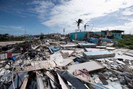As shown in a Dec. 21 photo, damage is still widespread across Marsh Harbour, Bahamas, following Hurricane Dorian's direct hit in September 2019.