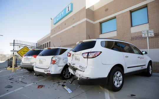 Three city vehicles and the El Paso Paso Times production gate were damage in a hit and run wreck early Sunday morning.