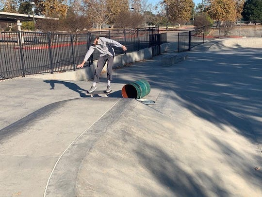 Joel Wood, 22, lands after skating over a trash barrel at Borchard Skate Park in Newbury Park. The Conejo Recreation and Park District plans to renovate and expand the facility.