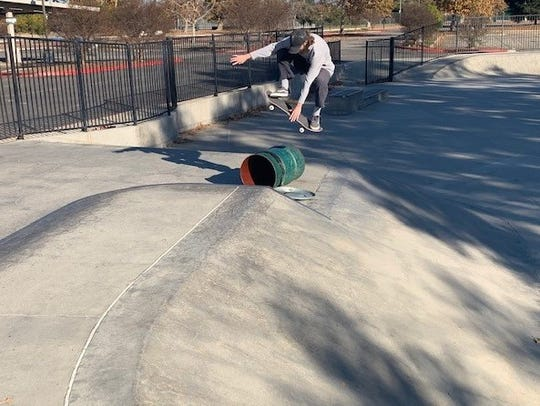Joel Wood, 22, skates over a trash barrel at Borchard Skate Park in Newbury Park. The Conejo Recreation and Park District plans to renovate and expand the facility.