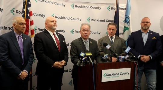 Rockland County Executive Ed Day announces that a private security firm, Brosnan Risk Consultants, will be providing security at synagogues in Rockland County. Speaking at the Rockland County Offices Dec. 30, 3019, Day said that the firm, led by Patrick Brosnan, to the right of Day, will be providing their services free of charge. Day said that the firm will work with local law enforcement after this weekend's stabbing of five Jewish worshipers at a Hanukkah gathering in Monsey.