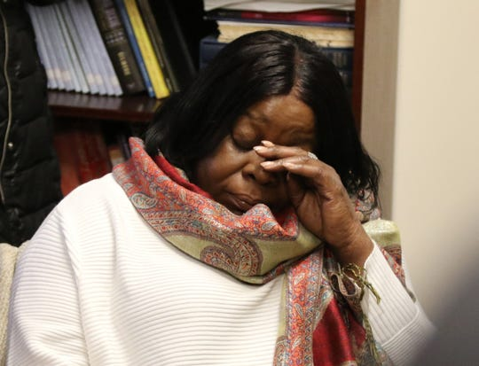 The mother of Grafton Thomas, Kim Thomas, listened and did not speak during a press conference at Michael Sussman's office in Goshen, N.Y. Dec. 30, 2019.