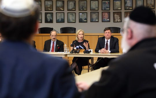 U.S. Sen. Kirsten Gillibrand hosts a roundtable discussion with Orthodox Jewish leaders and elected officials at Ramapo Town Hall Dec. 30, 2019 in the wake of the Monsey attack to talk about how to fight anti-Semitism and protect the Jewish community. She is joined by Congressman Elio Engel, left, and Ramapo Town Supervisor Michael Specht.