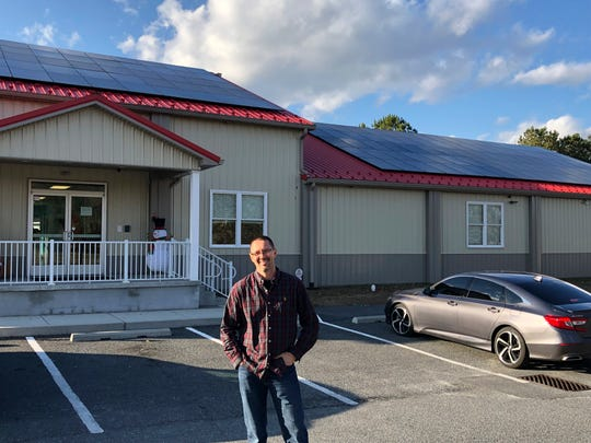 Businessman Richard Spinks stands outside his Gigglebugs early learning center in Millsboro, Del., on Wednesday. Dec. 18, 2019. Spinks, whose facility relies on rooftop solar panels to help control energy costs, successfully challenged Delmarva Power's interpretation of its solar energy tariff, which left him and other business owners facing the possibility of costly monthly bills from Delmarva, even though they might have net negative energy usage from the regional power grid.
