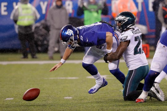 New York Giants quarterback Daniel Jones (8) reaches for the ball after losing control of it in front of Philadelphia Eagles strong safety Malcolm Jenkins (27) in the second half of an NFL football game, Sunday, Dec. 29, 2019, in East Rutherford, N.J. (AP Photo/Seth Wenig)