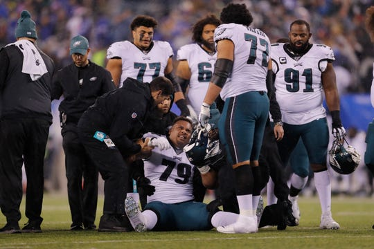 Philadelphia Eagles offensive guard Brandon Brooks (79) is helped up after being injured in the first half of an NFL football game against the New York Giants, Sunday, Dec. 29, 2019, in East Rutherford, N.J. (AP Photo/Adam Hunger)