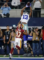 Dallas Cowboys wide receiver Michael Gallup (13) makes a catch for a touchdown over Washington Redskins wide receiver Terry McLaurin (17) during the second half of an NFL football game in Arlington, Texas, Sunday, Dec. 15, 2019. (AP Photo/Michael Ainsworth)