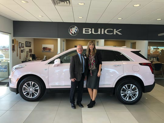 Patterson Auto sales associate Steve Garner is seen with Mary Kay consultant Wendy Masterson and her new pink Cadillac.
