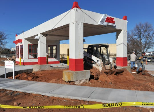 A construction crew works to put some finishing touches on Union Square's newest drive-thru location located at the corner of 6th Street at Indiana Avenue.