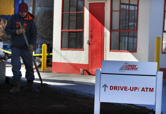 Construction crews work to put some finishing touches on Union Square's newest drive-thru location located at the corner of 6th Street at Indiana Avenue.