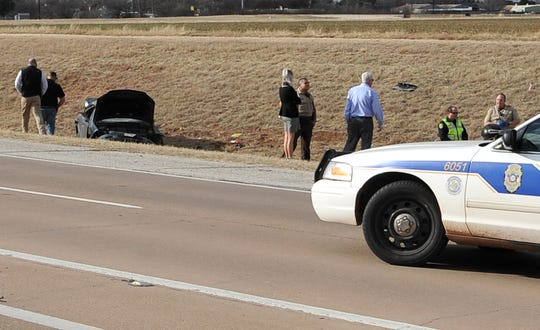 Wichita Falls police officers and Wichita County Sheriff's deputies investigate the scene of  a fatal accident on Henry S. Grace.