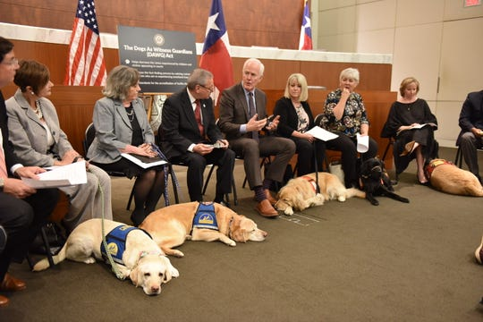 Sen. John Cornyn (R-TX) meets March 29 with certified facility dog handlers from various District Attorneys' offices, representatives from victims' support groups and local special court judges at the South Texas College of Law in Houston.