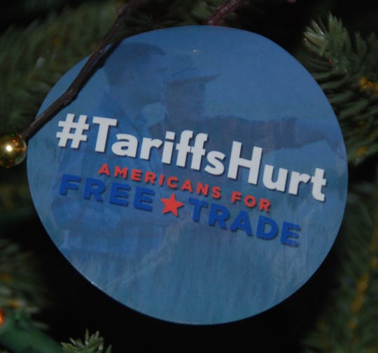 "Even the Christmas tree ornaments bore the message ""#Tariffs Hurt"" at an event highlighting the troubled business climate being created by trade uncertainty and expensive tariffs."