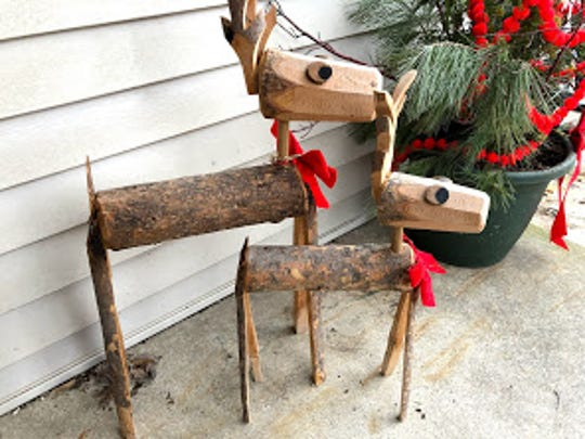 A pair or wooden, homemade deer crafted by Jerry Apps' son and family greet visitors at the front door of the Apps' household.