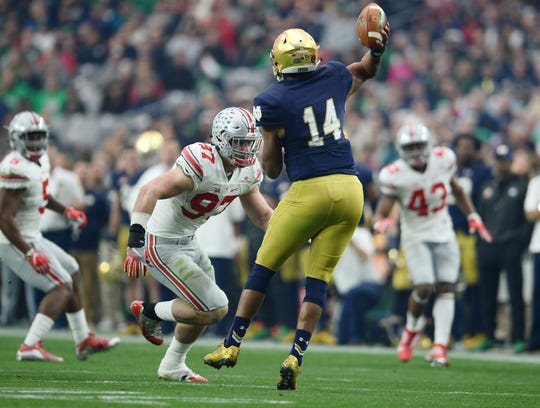 Ohio State defensive lineman Joey Bosa moves in to hit Notre Dame quarterback DeShone Kizer during the 2016 Fiesta Bowl at University of Phoenix Stadium.
