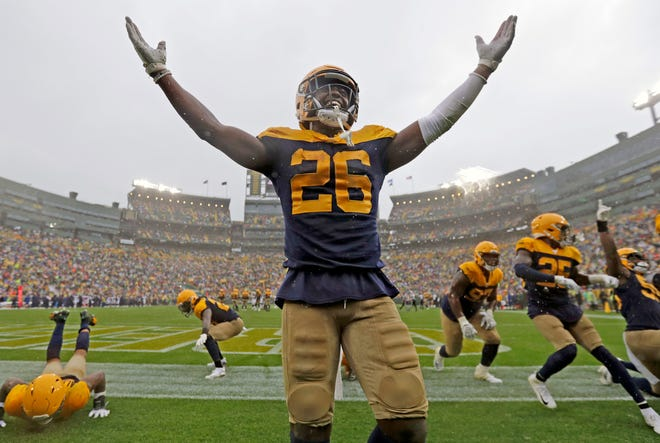Green Bay Packers defensive back Darnell Savage (26) celebrates after intercepting Denver Broncos quarterback Joe Flacco (5) in September 2019 at Lambeau Field. Photographer William Glasheen won a first-place award for this photo of the moment.
