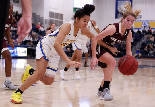 Manchester's Myah Hourigan and Red Bank's Caitlyn Decker chase after a loose ball during the WOBM Christmas Classic basketball tournament final between Red Bank Regional and Manchester. Toms River, New Jersey. Monday, December 30, 2019. David Gard /Correspondent