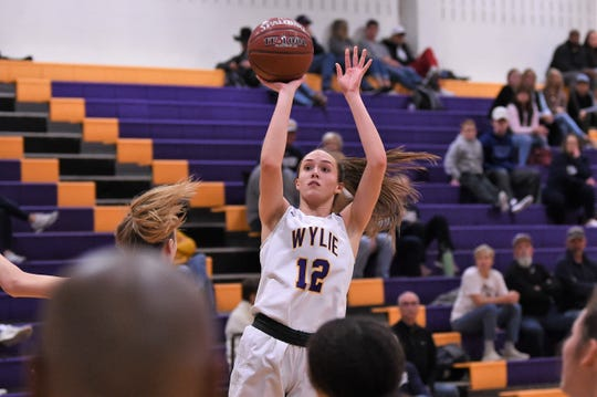Wylie's Karis Christian (12) goes up for a shot against Stephenville at Bulldog Gym on Tuesday, Dec. 31, 2019. Christian led the Lady Bulldogs with 14 points as they won 50-46.